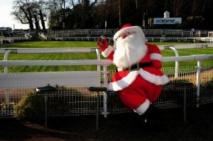 A Santa Claus during Tingle Creek Day at Sandown Park